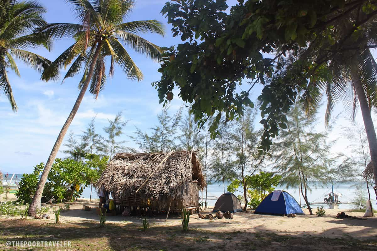 There are a few huts on the beach but most people bring their own tents.