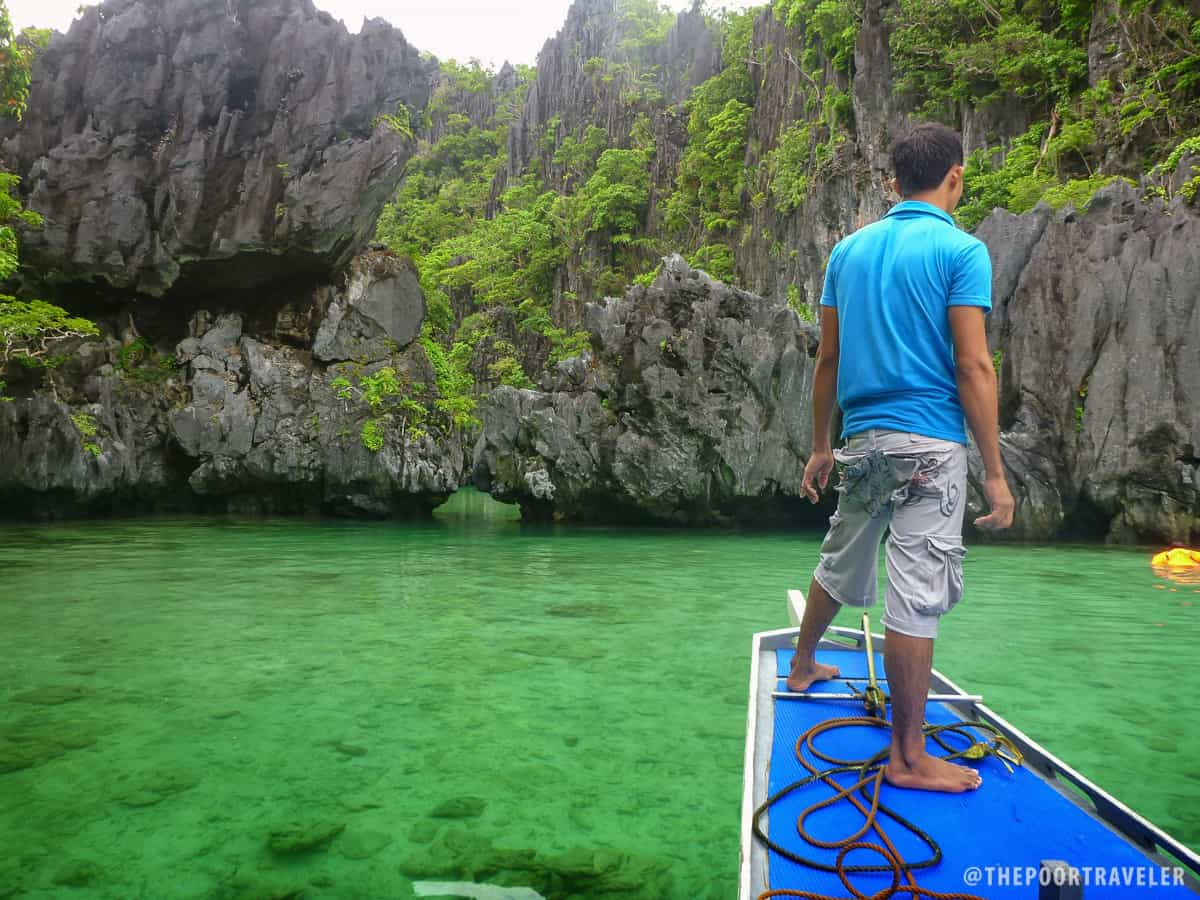 The gap to swim or kayak through to penetrate Small Lagoon. And that's our boatman.