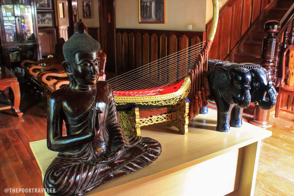A wooden image of Buddha at the common area
