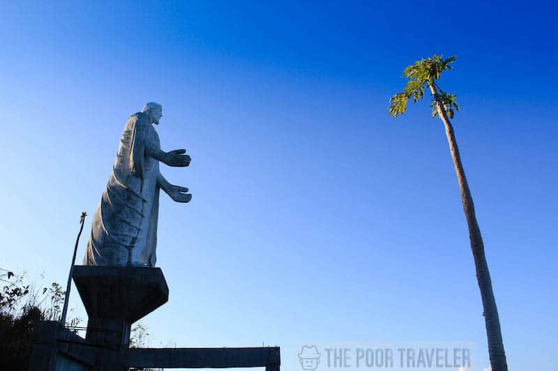 A closer look at the statue of Jesus Christ at Aguila viewpoint, overlooking the town.