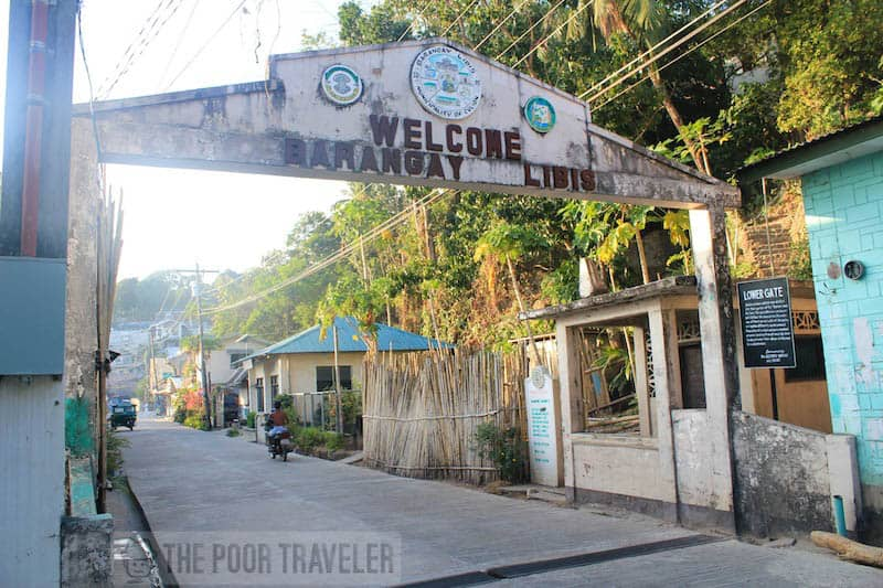 "Lower gate. This barangay arc marker used to divide the town into two: the worlds of ""leproso"" and the ""sano."" All health workers passing through must dip hands in and wipe shoes with a disinfectant."