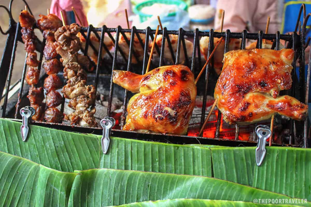 Grilled chicken tail, gizzard, and legs sold in the streets of Silom