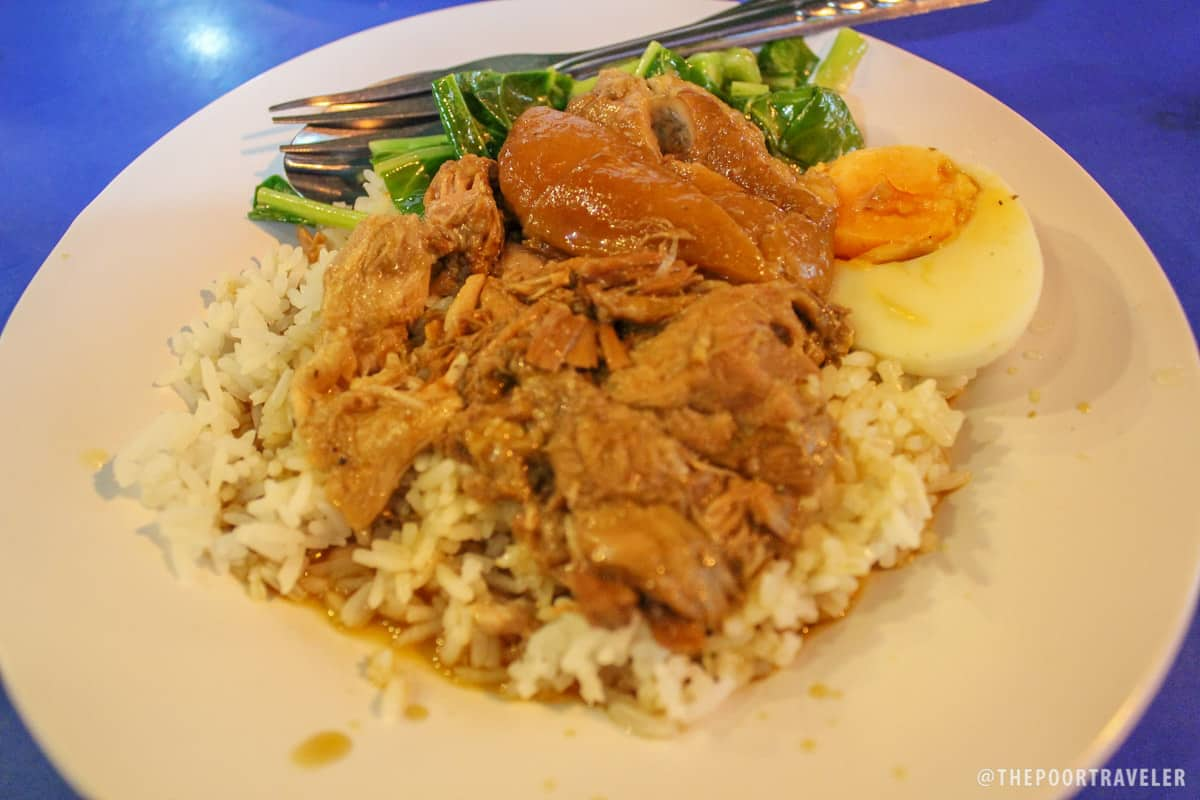 My favorite! Pork rice. Tender pork boiled in slightly sweet soup served with half egg, veggies, and rice.