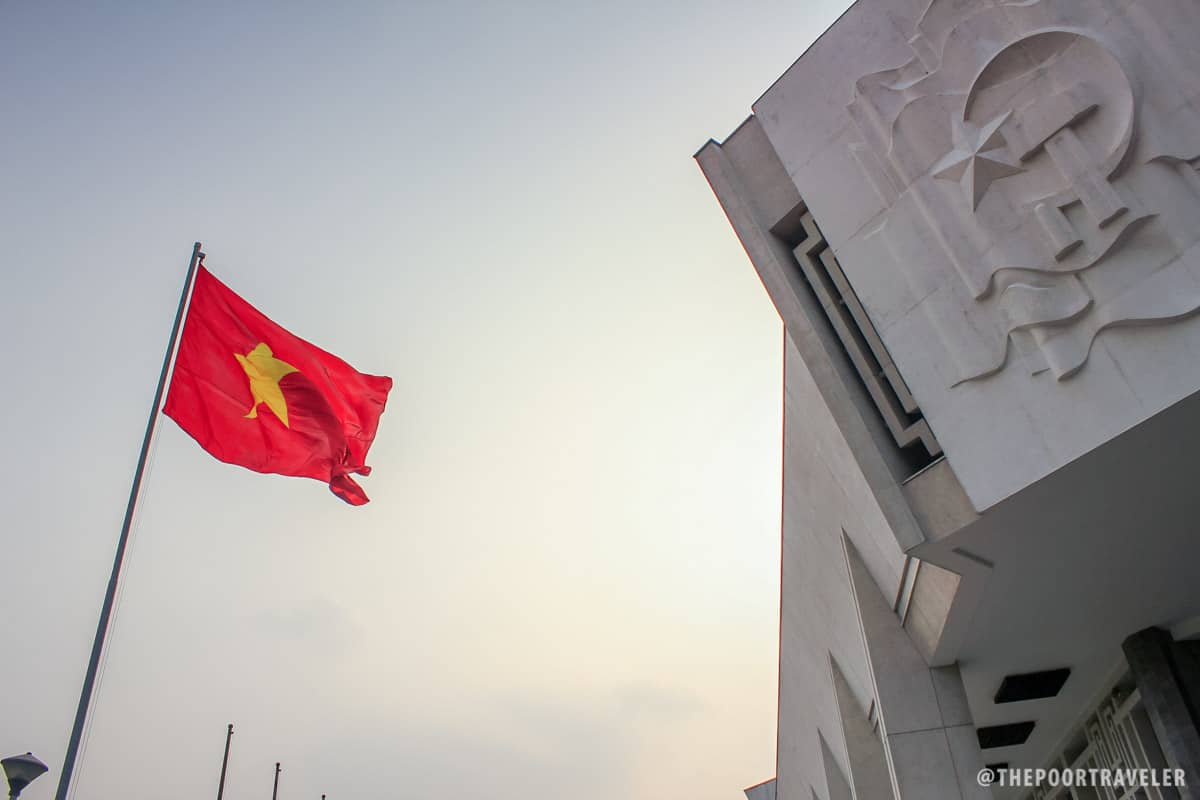 The Vietnamese flag waving proudly in front of Ho Chi Minh Museum