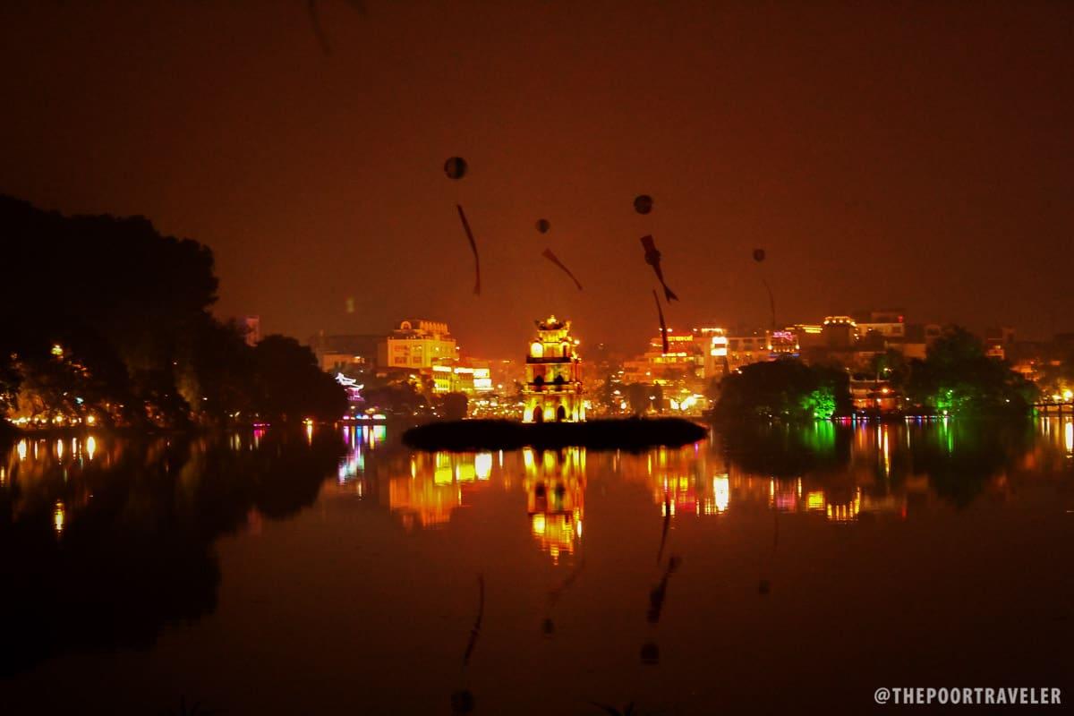 Glowing Lake: The Turtle Tower and Hoan Kiem Lake at night