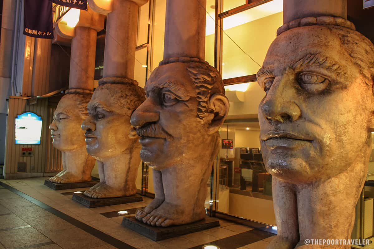 The legs have faces. These are the colonnade of Dotonbori Hotel