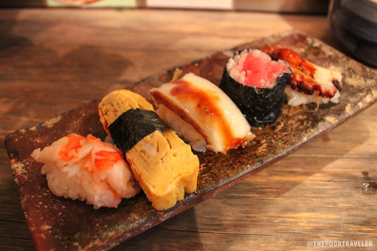 Sushi Plate #3: Ebi (shrimp), Tamago (sweet omelet), Awabi (abalone), Tekka (tuna roll), and Tako (octopus)