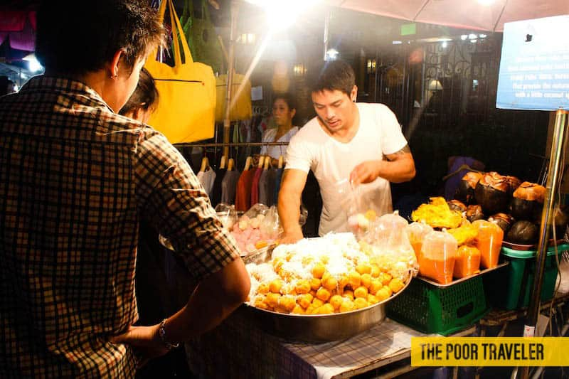 When my friends saw this picture, they drooled over  not the bread puffs but the vendor. Haha