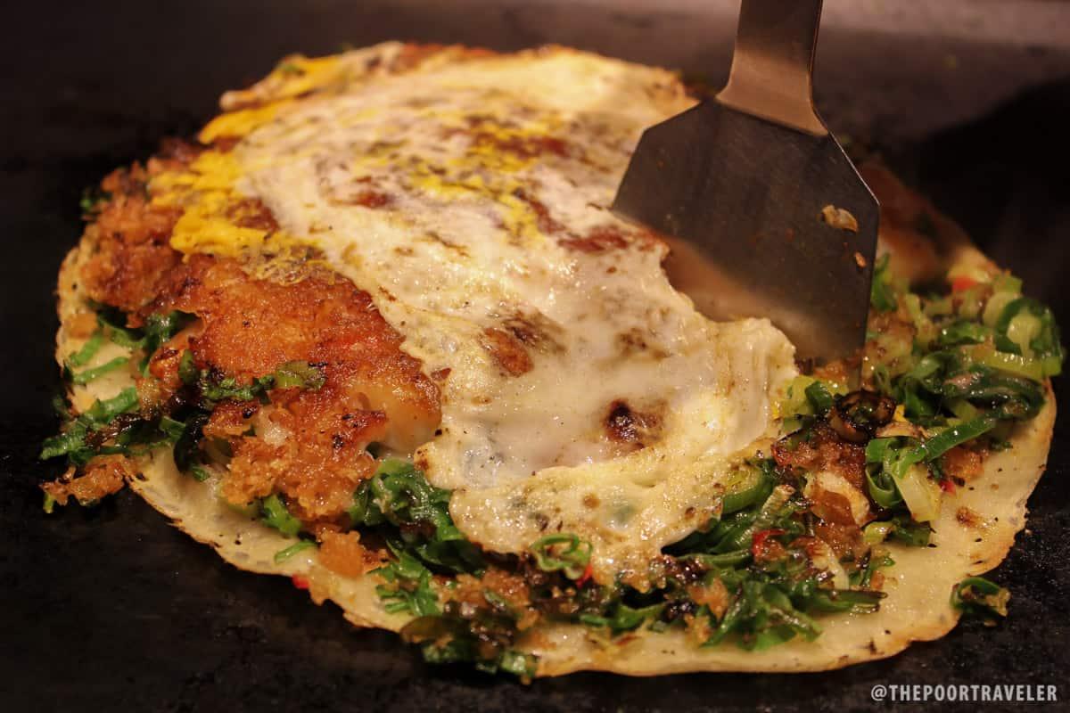 Negiyaki — wheat flour, kujo onions, eggs — with shrimps and clams (JPY 735)