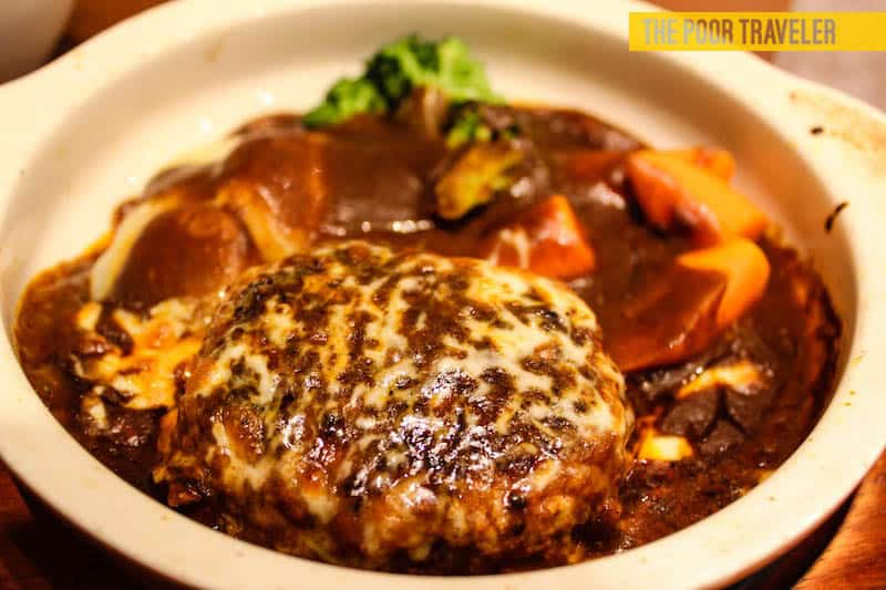 Hamburg Steak. Not really a Japanese dish but it's pretty popular in Kansai region. Available in most restaurants and even convenience stores!
