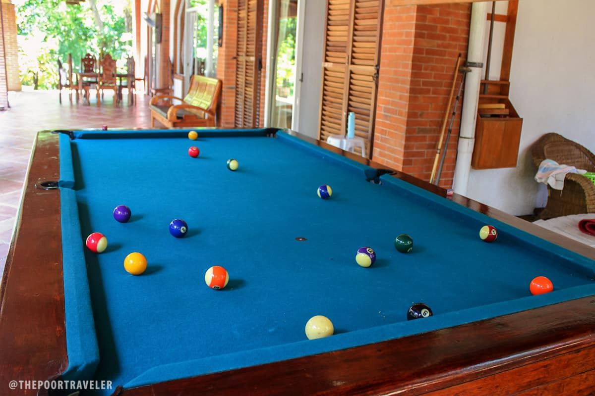 A billiards table by the garden