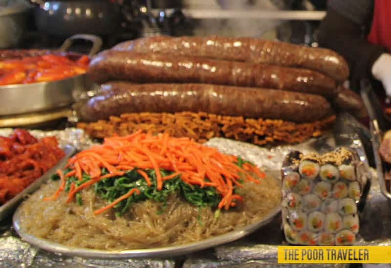 That weird sausage in the background is , cow intestines stuffed with pig's blood among others