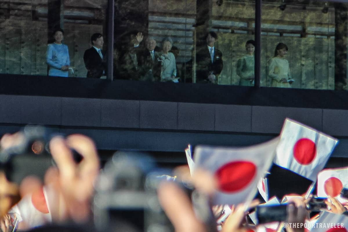 Emperor Akihito and Empress Michiko waved back at the crowd.