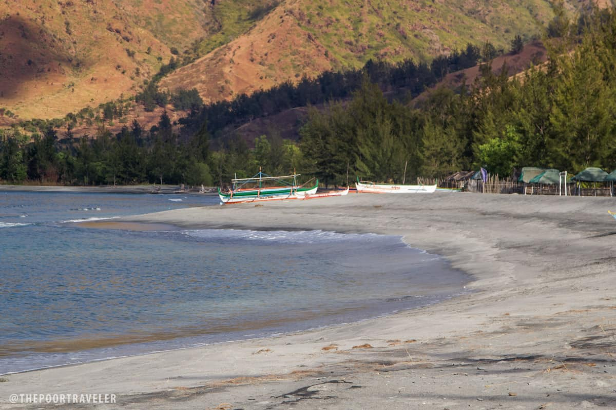 Silanguin's Beach is strewn with gray sand, not volcanic ash.