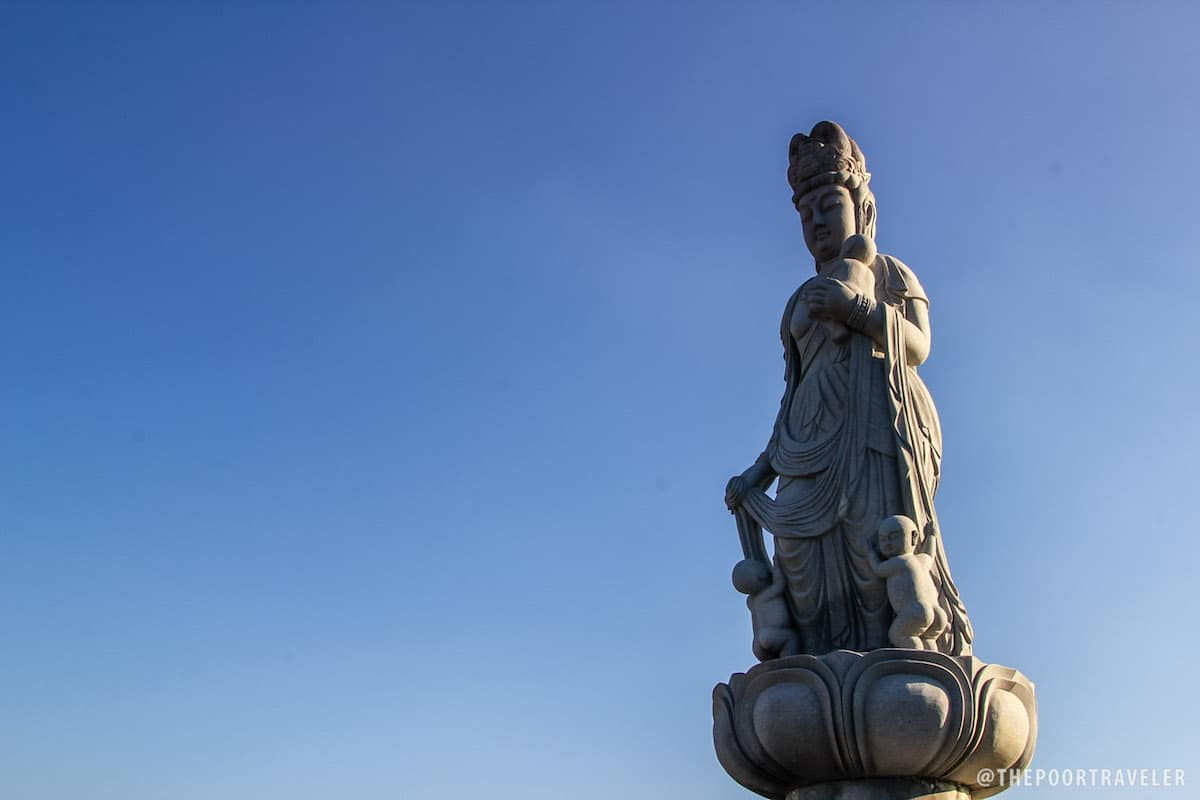 A fertility Buddha faces the direction of Japan.