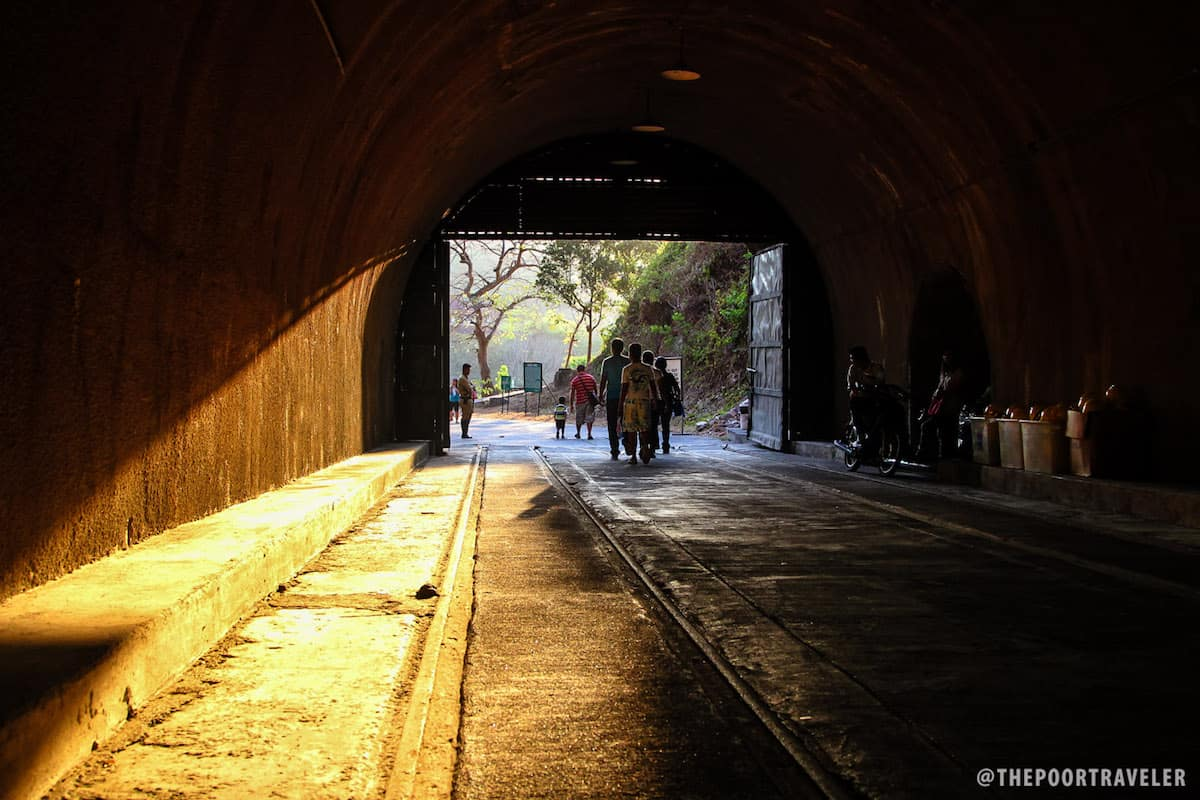 At the end of the tunnel, there are more tourists.