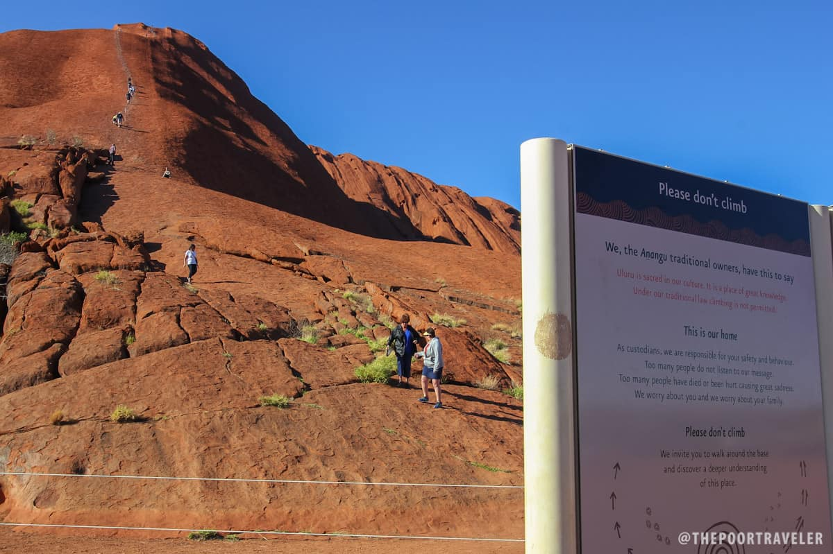Some visitors still choose to climb Uluru despite warnings.