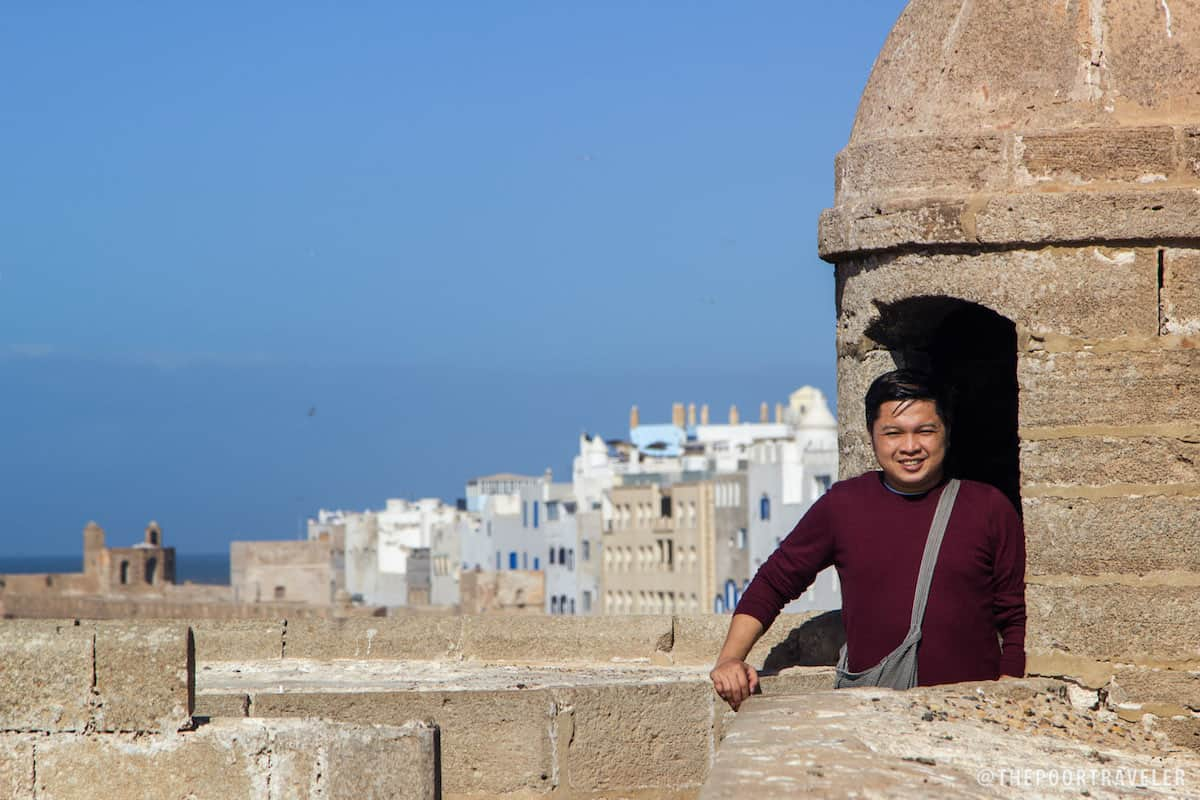 This is me hiding in one of the turrets atop Skala du Port. Walled medina in the background.
