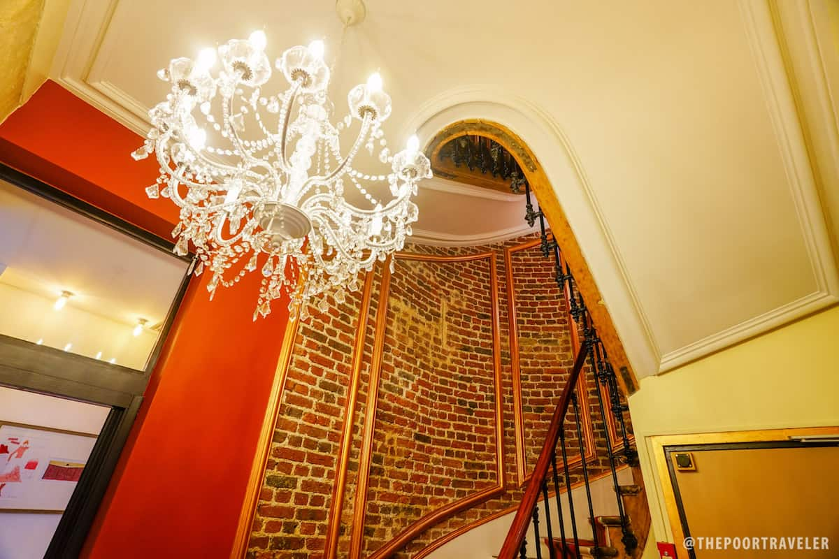 Chandelier and grand staircase, surrounded by red brick, London-style